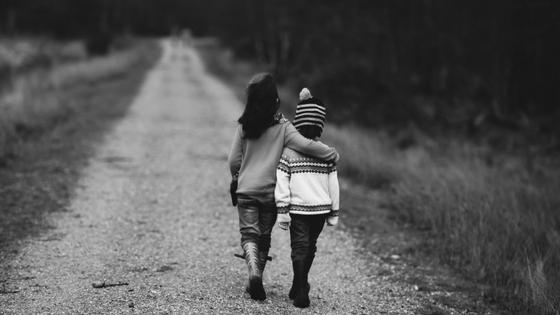 children arm over shoulder - bw